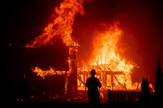 A house burns while Camp Fire is unleashed through Paradise, California, on Thursday, November 8, 2018.
