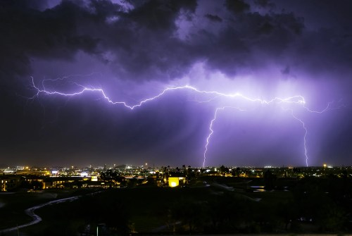Lightning strikes over the East Valley as a monsoon storm approaches Phoenix on July 22, 2019.