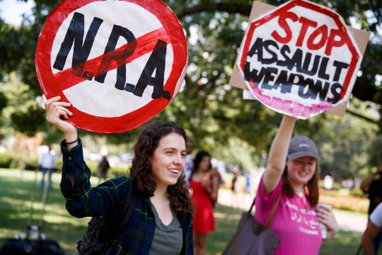 Demonstrators protest gun violence across from the White House on Tuesday.
