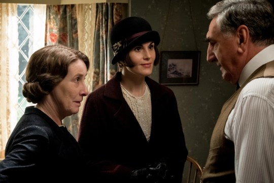 """Lady Mary (Michelle Dockery, center) readies for a royal visit alongside Mrs. Hughes (Phyllis Logan) and Mr. Carson (Jim Carter) in """"Downton Abbey."""""""