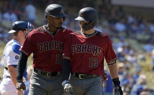 Aug 11, 2019: Arizona Diamondbacks shortstop Nick Ahmed (13) celebrates with right fielder Adam Jones (10) after hitting a two-run home run in the ninth inning against the Los Angeles Dodgers  at Dodger Stadium. The Dodgers defeated the Diamondbacks 9-3.