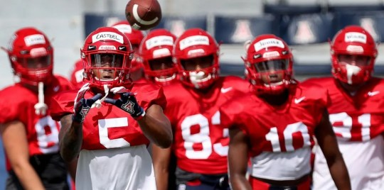 UA wide receiver Brian Casteel takes a throw as the receivers run through their drills during a practice last week. The Wildcats open their season Aug. 24.