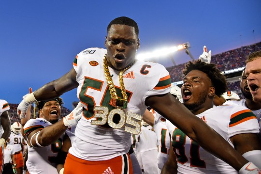 Miami Hurricanes linebacker Shaquille Quarterman celebrates with the turnover chain after recovering a fumble against the Florida Gators during the first half.
