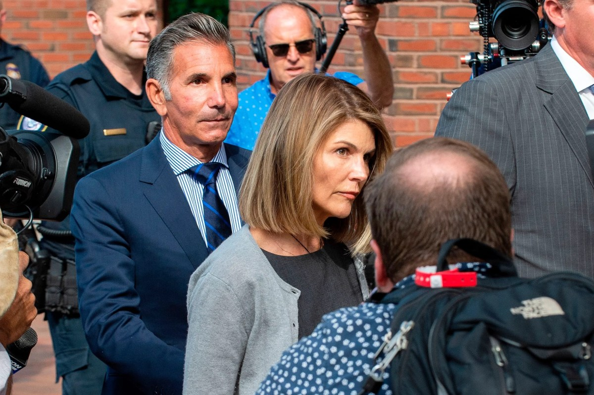 Lori Loughlin and her husband Mossimo Giannulli leave the federal court in Boston after a pretrial hearing with magistrate judge Kelley in the United States court John Joseph Moakley in Boston on August 27, 2019. Loughlin and Giannulli are charged Of conspiracy to commit postal and electronic fraud. and conspiracy to commit money laundering in the university admission scandal.