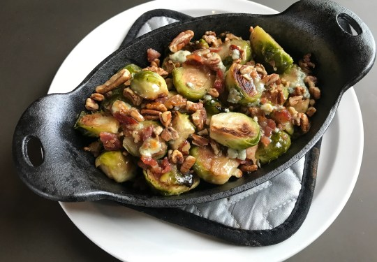 The new Back Bay Pizza & Cocktails offers cast-iron small plates like these Brussels sprouts roasted in bacon fat.