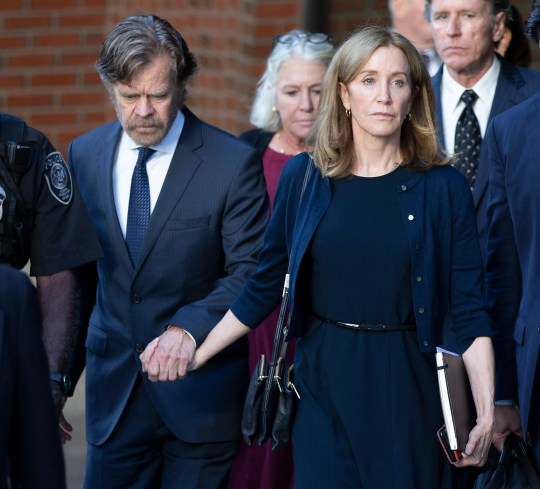 Felicity Huffman and her husband, actor William H Macy, leave the federal courthouse in Boston following her sentencing in the college admission scandal, Sept. 13, 2019. She was sentenced to 14 days in prison, $30,000 fine and 250 hours of community service.