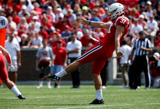 Cincinnati Bearcats punter James Smith (37) punts the ball away in the first quarter of the NCAA football game between the Cincinnati Bearcats and the Miami (Oh) Redhawks at Nippert Stadium in Cincinnati on Saturday, Sept. 14, 2019. The Bearcats retained the Victory Bell trophy for the 14th consecutive year with a 35-13 win.