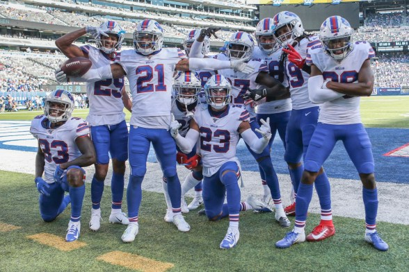 Buffalo Bills free safety Jordan Poyer (21) celebrates with teammates after an interception against the New York Giants during the second half at MetLife Stadium.