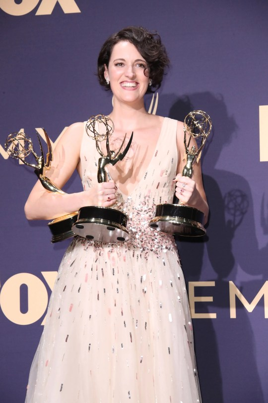 """Phoebe Waller-Bridge, winner of the awards for outstanding lead actress in a comedy series, outstanding comedy series, and outstanding writing for a comedy series for """"Fleabag,"""" poses in the press room during the 71st Emmy Awards at the Microsoft Theater."""