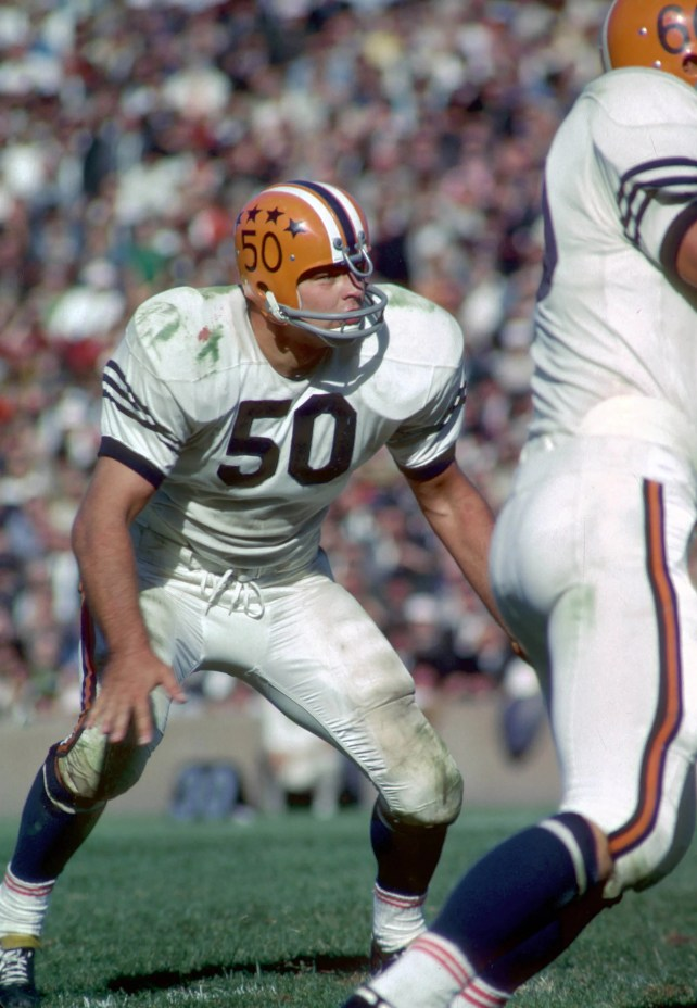 Dick Butkus vs. Red Grange key Elite Eight matchup to help find college football's GOAT