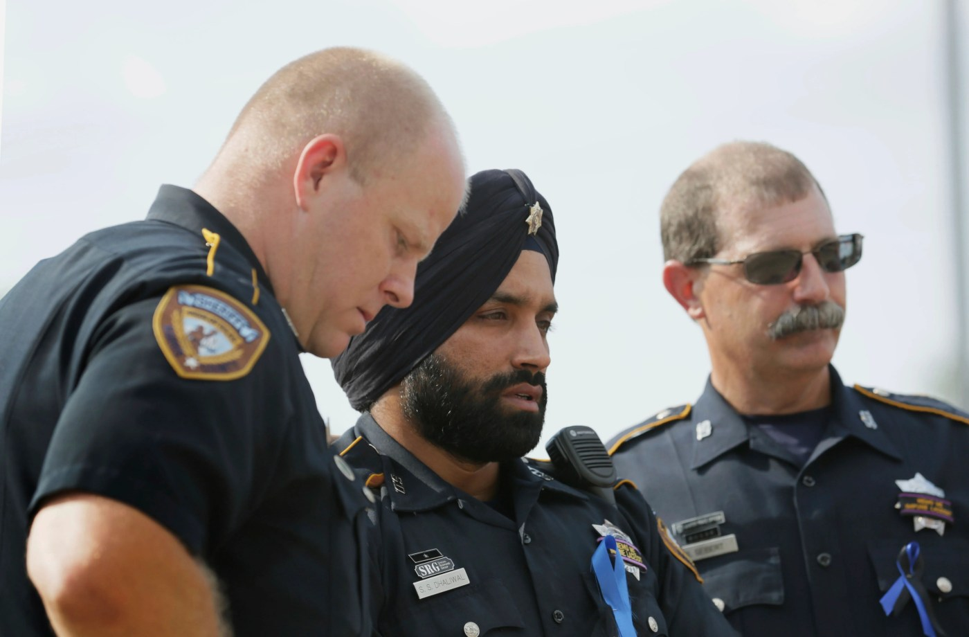 In this Aug. 30, 2015, photo, Harris County Sheriff's Deputy Sandeep Dhaliwal, center, is seen during a memorial for Deputy Darren Goforth in Houston. Dhaliwal was shot and killed while making a traffic stop Friday, Sept. 27, 2019, near Houston.