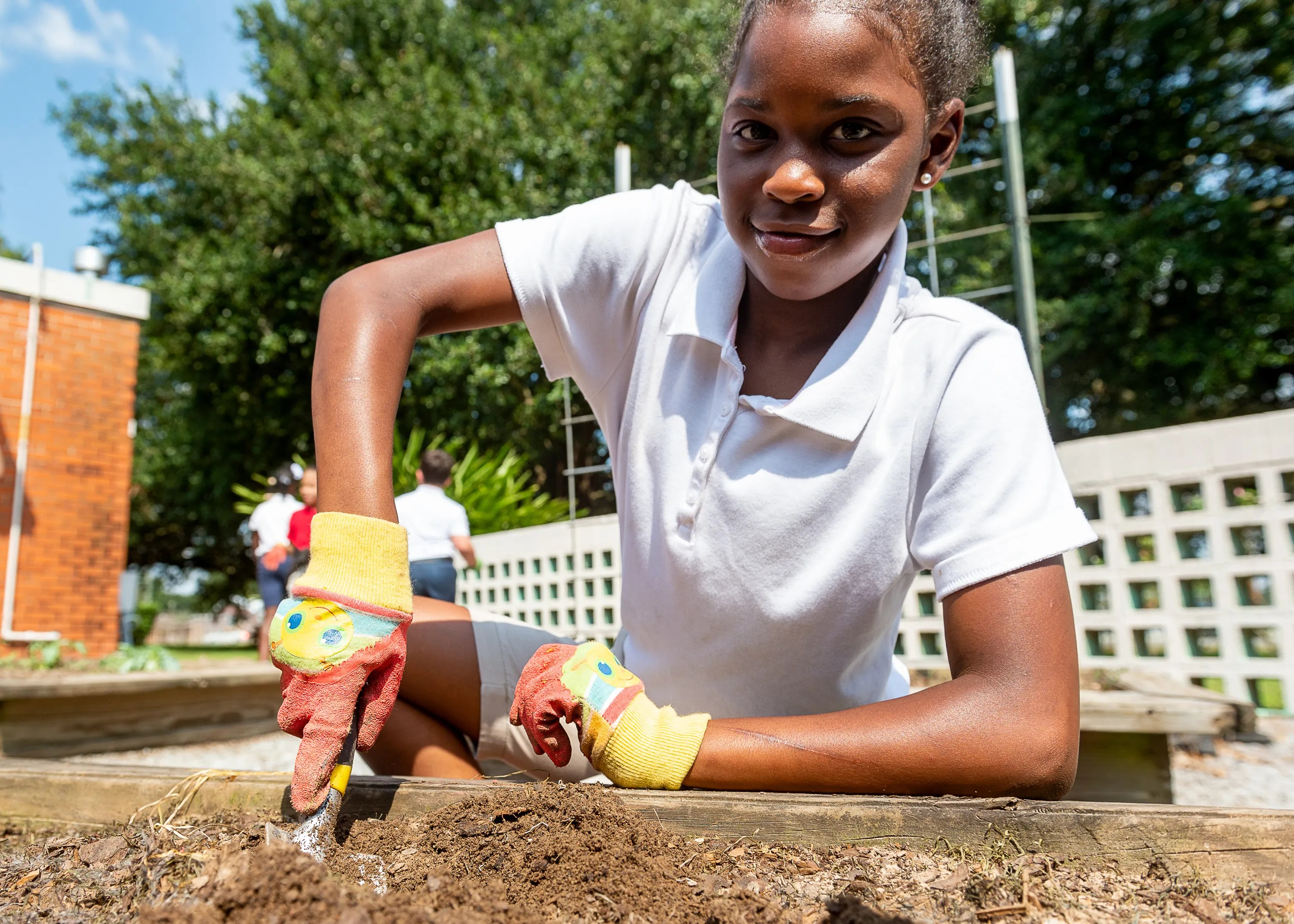 Jariah Wilson, a student at  James A. Herod Elementary, works in the school's garden in Abbeville Wednesday, Oct. 2, 2019.