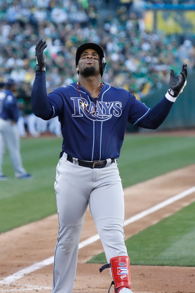 Rays blast four homers, power past Athletics to win AL wild-card game