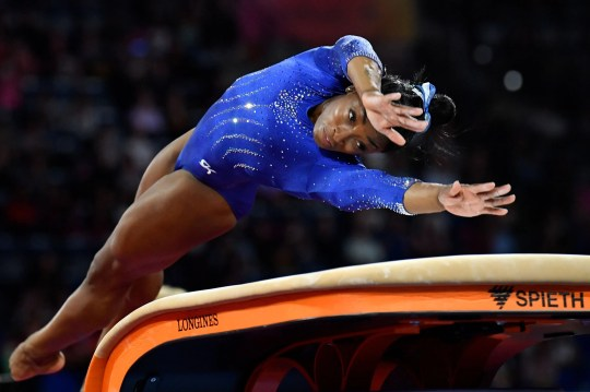 Simone Biles performs on the vault during a training session in preparation for the world championships in Germany.