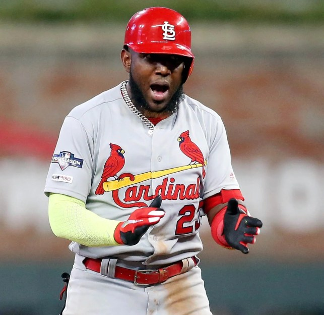 Cardinals rally late, hold off Braves ninth inning run to win Game 1 of NLDS