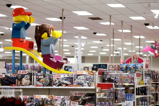In this Friday, Nov. 16, 2018, file photo photo a display shows two large Lego toys on a slide near the toy section at a Target store in Bridgewater, N.J.