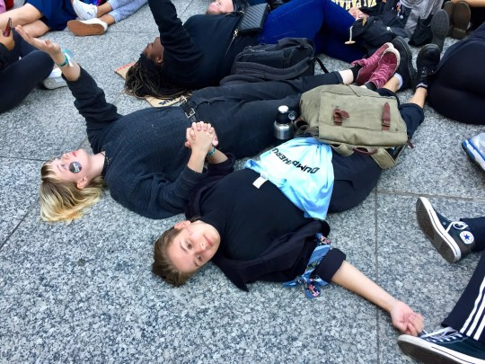 "Students with Illinois Youth Climate Strike stage a ""die-in"" across from City Hall in Chicago, Illinois on Oct. 7, 2019."