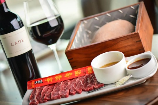 The Devil's Cut Hot Rock featuring Wagyu beef at Bourbon & Bones.