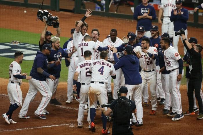 Astros shortstop Carlos Correa is mobbed by his teammates after his walk-off homer.
