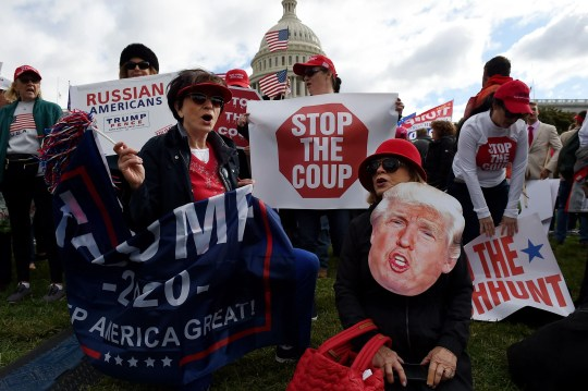"""Supporters of President Donald Trump hold a """"Stop Impeachment"""" rally in front of the US Capitol Oct. 17, 2019 in Washington, DC."""