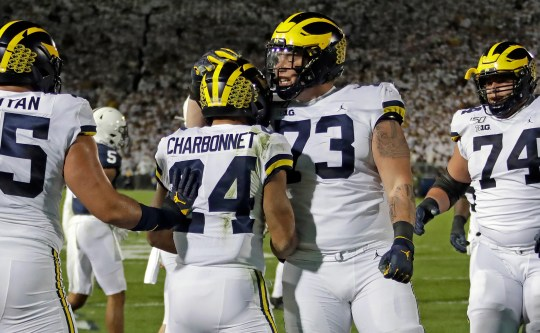 Michigan, which stretches west of the Charbonnet Zach, landed with Jalen Mayfield (73) in the first half against Penn State in State College, Pa, on Saturday, October 19, 2019.