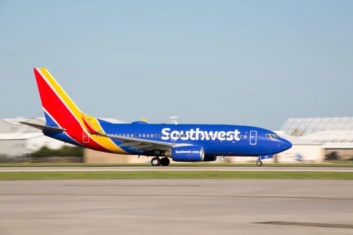 A Southwest Airlines' plane landing at an airport, corporate culture