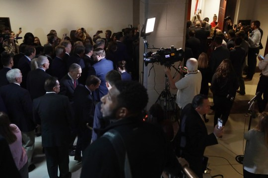 About two dozen House Republicans enter a secure room, called a sensitive compartmented information facility (SCIF), where the House Intelligence, Foreign Affairs and Oversight committees have taken private depositions in the impeachment inquiry at the U.S. Capitol on Oct. 23, 2019 in Washington, D.C.