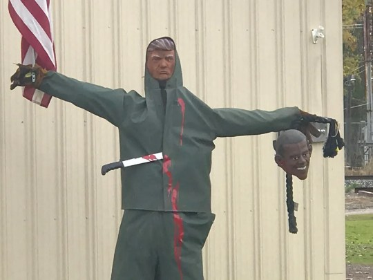 The scarecrow outside of Quality Coatings in Fowlerville pictured last week, before the owner changed the display.