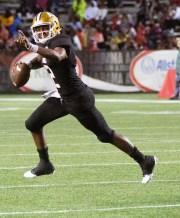 ASU quarterback KHA'Darrius Davis (2) points to a receiver before throwing the ball.