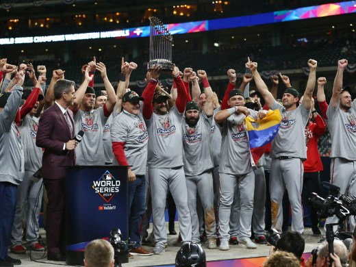 Nationals manager Dave Martinez and his team hoist the World Series trophy.