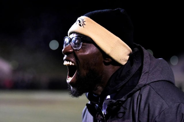 Western Michigan graduate assistant Leo Ekwoge reacts to the Broncos recovering the ball from Ball State University on Tuesday, Nov. 5, 2019 at Waldo Stadium in Kalamazoo, Mich.