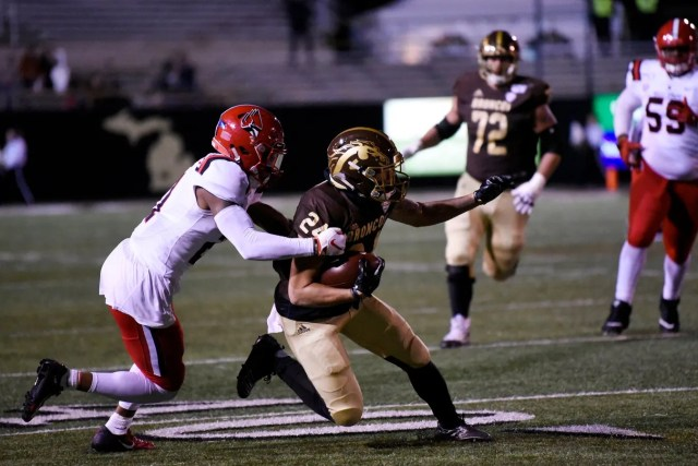 Ball State Cardinals center back Antonio Phillips (21) tackles Western Michigan Broncos wide receiver Brandon Hinds (24)on Tuesday, Nov. 5, 2019 at Waldo Stadium in Kalamazoo, Mich.