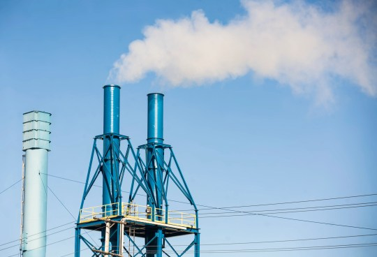 Smoke billows from a smokestack at the Exide Technologies plant in Muncie.