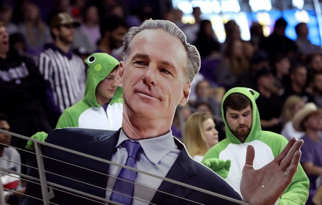 Nov. 18: TCU Horned Frogs fans hold up a sign of head coach Jamie Dixon during the second half against the Air Force Falcons at Ed and Rae Schollmaier Arena.