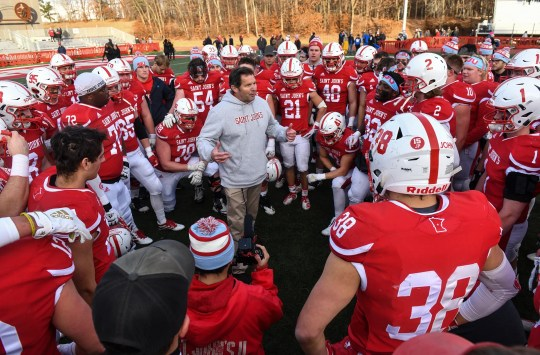 St. John's head coach Gary Fasching talks to his players following their 51-47 win Saturday, Nov. 23, 2019, against Aurora University at Clemens Stadium in Collegeville.