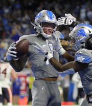 Latest Sports News: Detroit Lions receiver Marvin Jones celebrates his first-quarter touchdown against the Chicago Bears, Thursday, Nov. 28, 2019 at Ford Field.