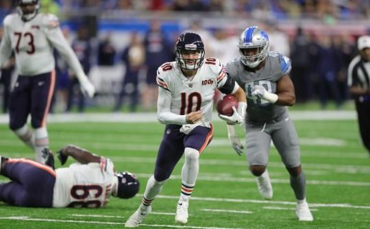 Latest Sports News: Chicago Bears quarterback Mitchell Trubisky runs by Detroit Lions linebacker Jarrad Davis (40) during the second half Thursday, Nov. 28, 2019 at Ford Field.