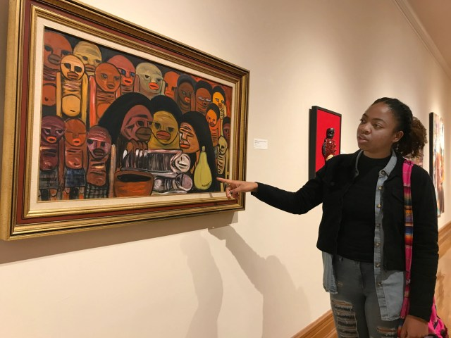 """Shea Downey, a fine art artist at the US State University, pays attention to her favorite artwork from the exhibition, """"A Taste of Culture: The Impact of Africa on American Culture,"""" at Hampton University Museum in Hampton, Virginia, Friday, 22 November. , 2019."""