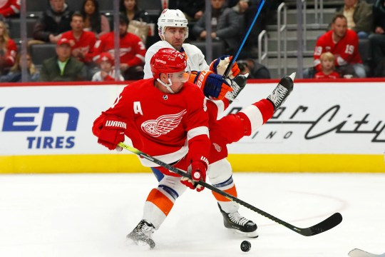 Large Red Detroit Red Larkin (71) venue holds Nick Leddy (2), a New York City defensive man trying to shoot December 2, 2019, in Detroit.