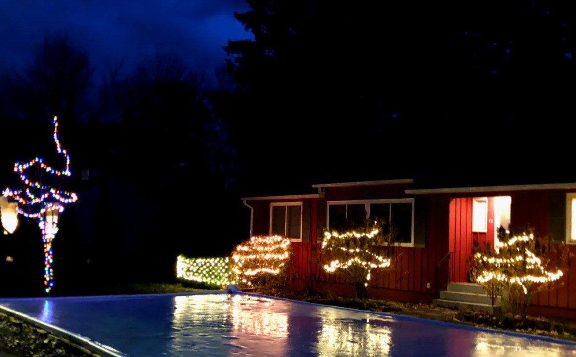 An ice rink in the front yard reflects holiday lights at a home in South Burlington on Tuesday, Dec. 10, 2019.