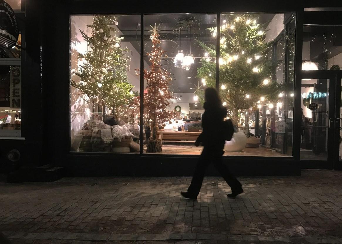 Tree-mounted lights decorate the Slate shop window on Church Street in Burlington on Dec. 19, 2019.