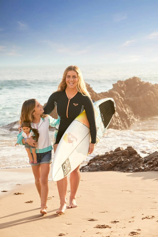Caroline Marks, who has qualified for the 2020 Olympics in surfing, poses with the American Girl of the Year Joss.