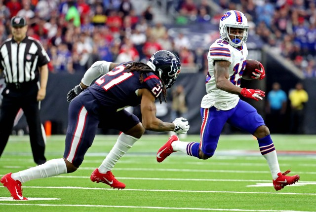 Buffalo Bills wide receiver Isaiah McKenzie (19) runs the ball against Houston Texans cornerback Bradley Roby (21) during the first quarter in the AFC wild-card playoff game at NRG Stadium.