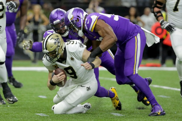 Saints quarterback Drew Brees gets sacked in the first quarter.