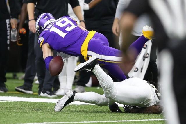 Vikings wide receiver Adam Thielen fumbles the ball during the first quarter.
