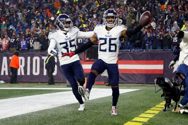 Tennessee Titans cornerback Logan Ryan (26) celebrates with defensive back Tramaine Brock (35) after scoring a touchdown on an interception against the New England Patriots during the second half at Gillette Stadium.