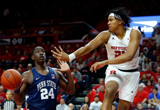Rutgers Scarlet Knights guard Ron Harper Jr. (right) passes the ball away from Penn State Nittany Lions forward Mike Watkins (24)