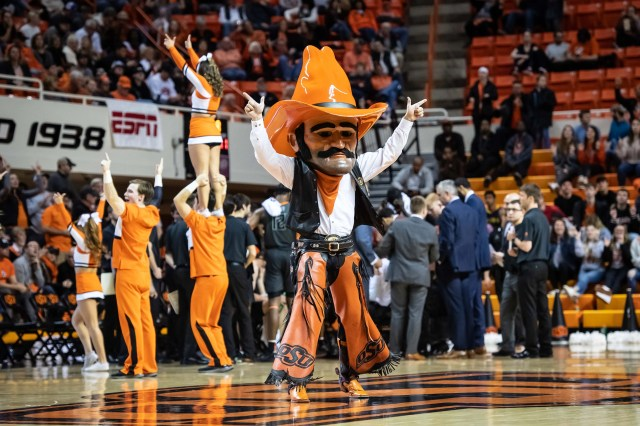 Jan. 6: Oklahoma State mascot Pistol Pete performs during a time out in the game against West Virginia at Gallagher-Iba Arena.