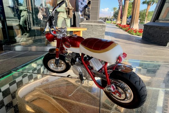 The first car that started the auction is not really a car, but a custom Honda mini bike.