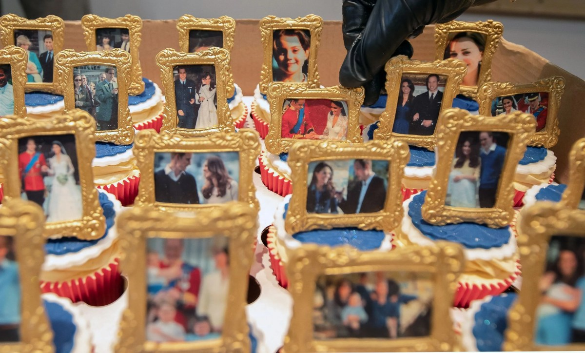 Cubcakes decorated with frames with images of Prince William, Duchess Kate and their children delighted the couple during their visit to Bradford in northern England on January 15, 2020.